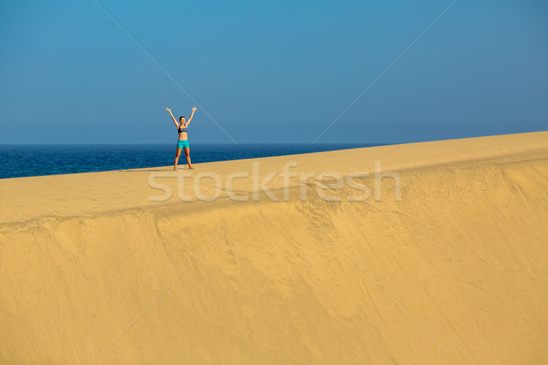 Woman with arms up raised on sand desert dunes Stock photo © blasbike