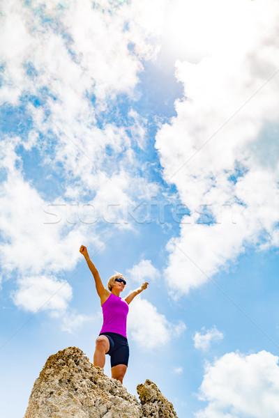 Happy woman on mountain top smiling Stock photo © blasbike