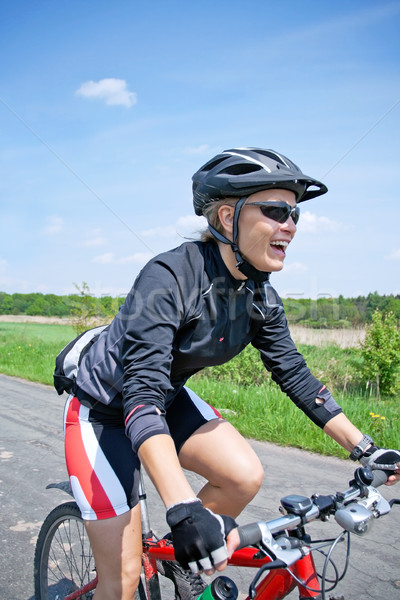 Woman riding on bicycle on summer day Stock photo © blasbike