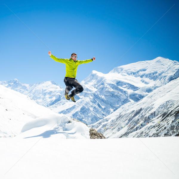 Happy man jumping success in mountains Stock photo © blasbike