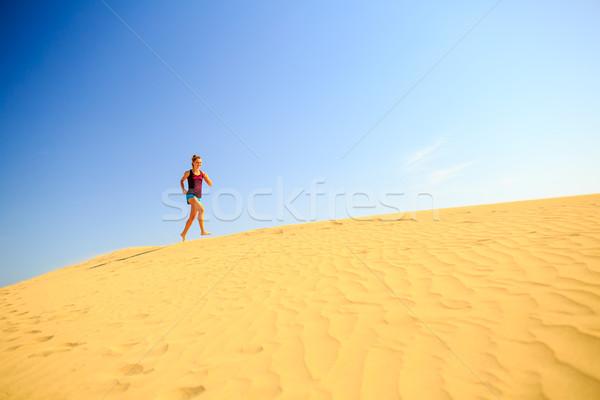 Young woman running on sand desert dunes Stock photo © blasbike