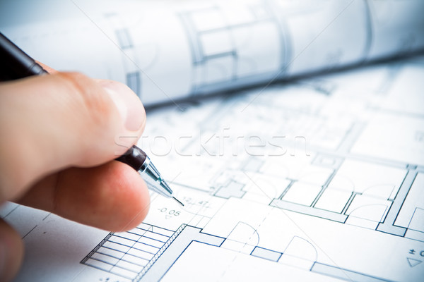 Stock photo: Architect working on blueprints
