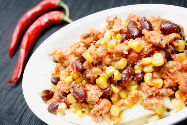 Chili con carne and red peppers Stock photo © blasbike