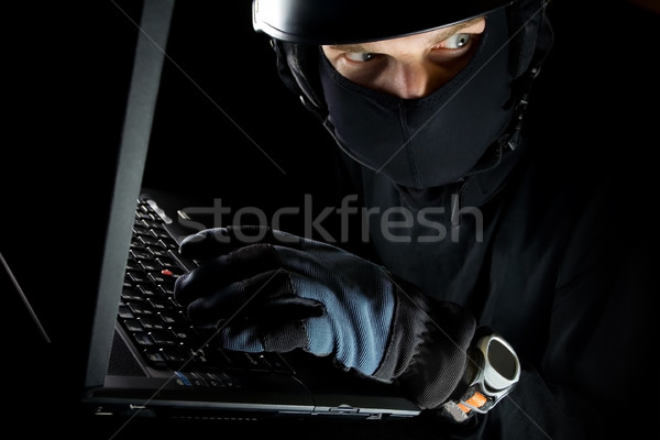 Security concept with man and computer at night Stock photo © blasbike