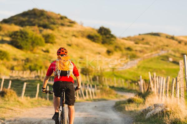 Bicycle riding enduro adventure in sunset mountains Stock photo © blasbike