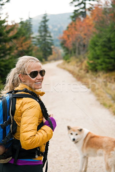 Woman hiking in mountains with akita dog Stock photo © blasbike