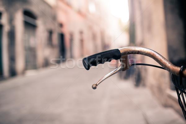 City bicycle handlebar, bike over blurred beautiful bokeh backgr Stock photo © blasbike