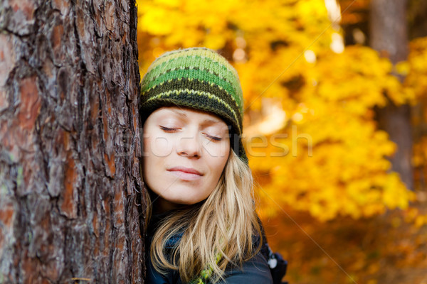 Happy Girl in Autum Forest Hugging Tree Stock photo © blasbike