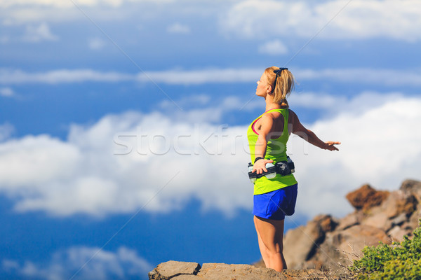Happy woman runner arms raised outstretched freedom Stock photo © blasbike