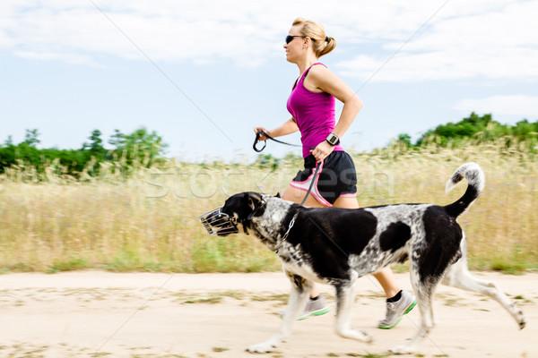 Woman runner running, walking dog in summer nature Stock photo © blasbike