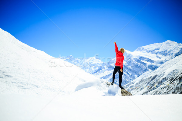 Woman success climbing on mountain peak Stock photo © blasbike