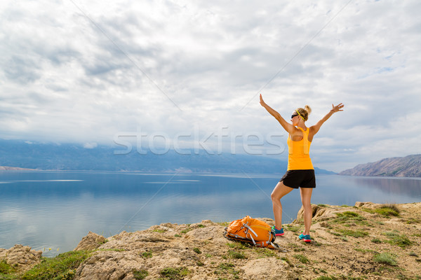 Woman hiking climbing success, hiker at seaside and mountains Stock photo © blasbike