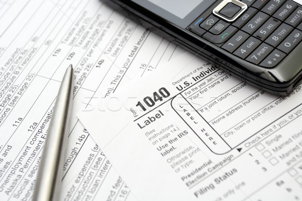1040 tax return form cell phone and pen Stock photo © blasbike