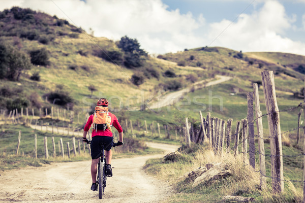 Mountain biker riding on bike in inspiring landscape Stock photo © blasbike