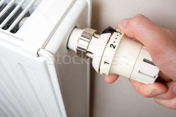 Radiator adjustment closeup. Man's hand adjusting radiator tem Stock photo © blasbike