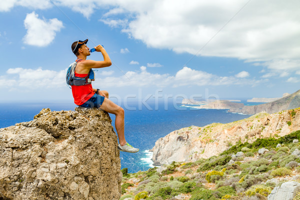 Hiking man looking at inspirational view Stock photo © blasbike