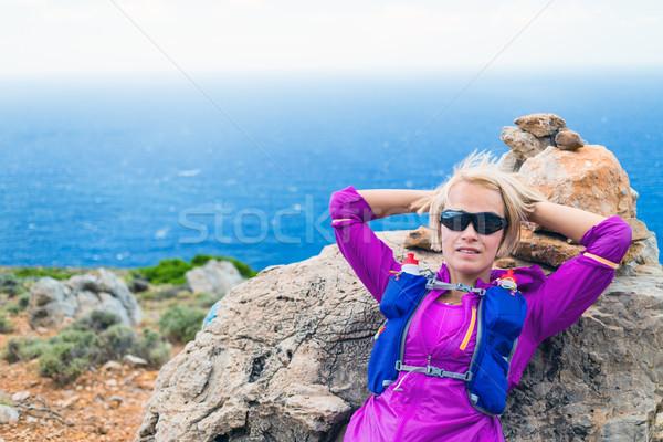 Stock photo: Happy woman runner hiker relaxing