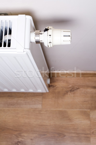 Radiator with thermostat in home interior Stock photo © blasbike