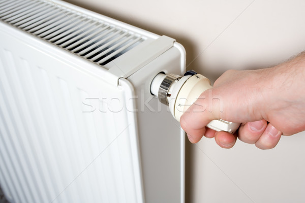 Thermostat adjustment by man's hand Stock photo © blasbike