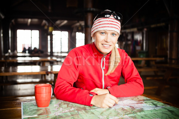 Woman hiker with map planning trip Stock photo © blasbike