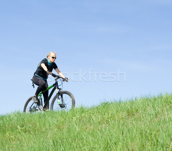 Young woman riding a mountain bike Stock photo © blasbike
