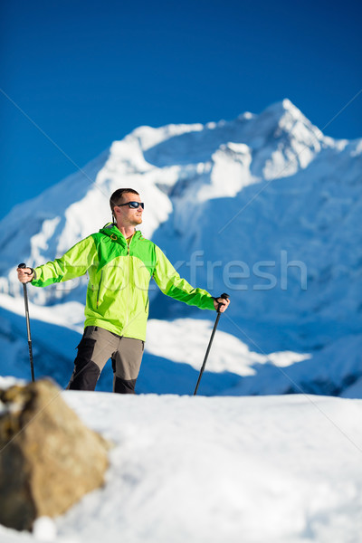 Man hiking in winter Himalaya Mountains Stock photo © blasbike