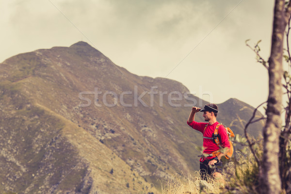 Stock photo: Hiking man or trail runner in mountains