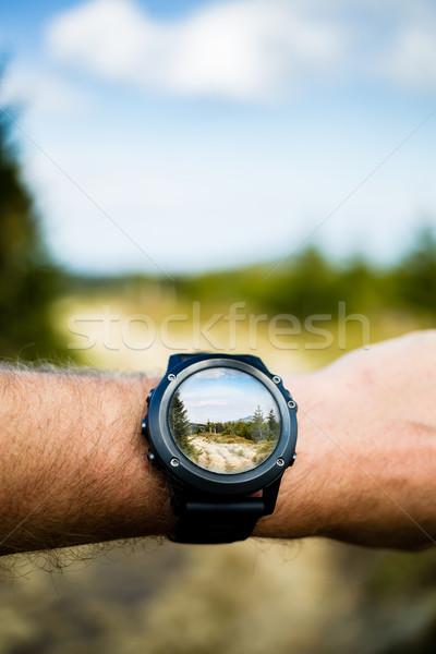 Taking photo with smartwatch camera, wearable technology Stock photo © blasbike