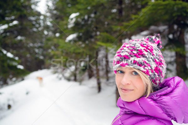 Happy woman walking in winter forest with dog Stock photo © blasbike