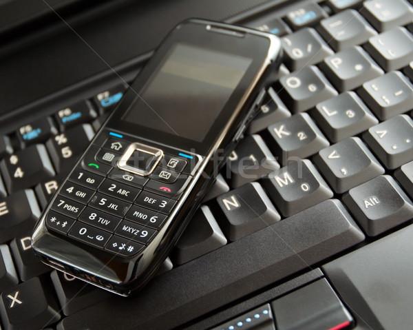Téléphone portable clavier d'ordinateur portable noir technologie sans fil portable clavier Photo stock © blasbike