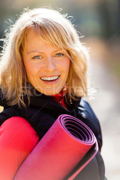 Feliz mulher jovem ioga jovem sorridente Foto stock © blasbike