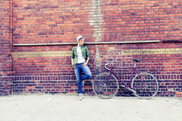 Young woman with vintage road bike in city Stock photo © blasbike