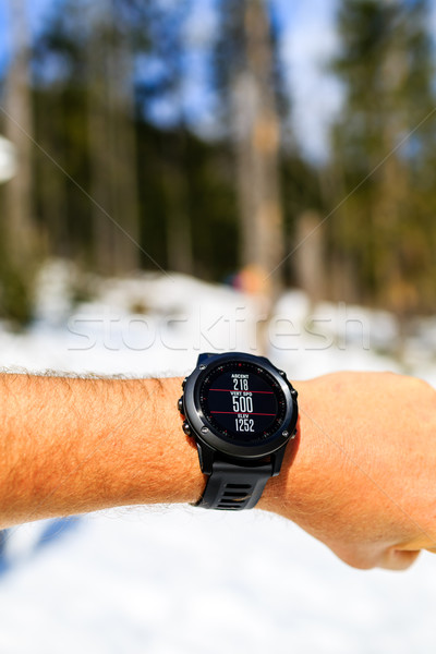 Runner on mountain trail looking at stopwatch, activity tracker Stock photo © blasbike