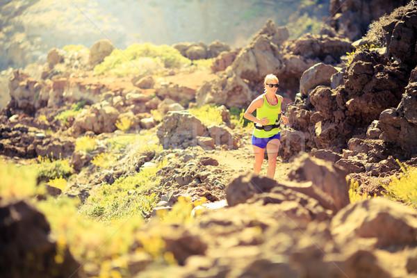 Happy woman running in mountains summer sunset Stock photo © blasbike