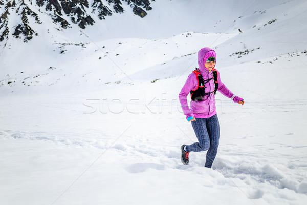 Happy woman winter trail running in beautiful inspirational land Stock photo © blasbike