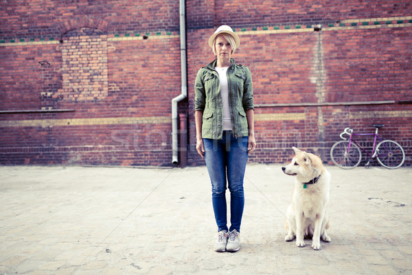 Hipster woman with dog and vintage road bike in city Stock photo © blasbike
