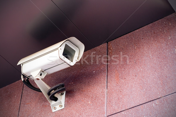 Stock photo: Security camera on office building