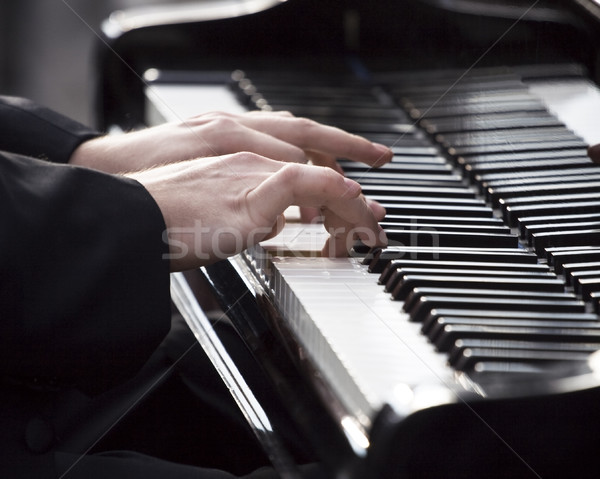 Playing piano Stock photo © blasbike