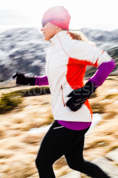 Young woman running in mountains on winter fall sunny day Stock photo © blasbike