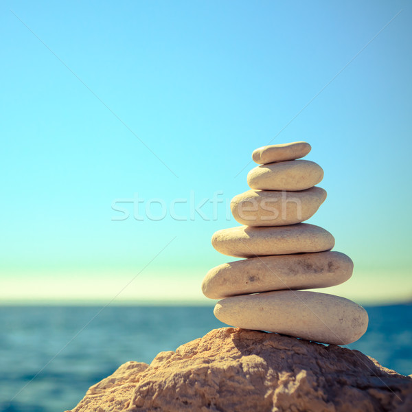 Stones balance at the beach, stack over blue sea Stock photo © blasbike