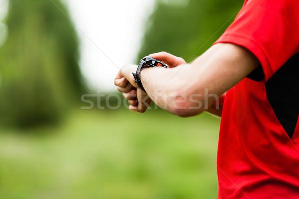 Runner checking GPS Stock photo © blasbike
