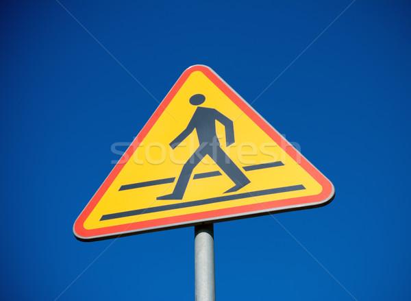 Crosswalk sign and clear blue sky Stock photo © blasbike