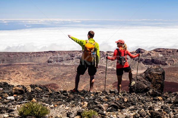 Couple hikers in high mountains Stock photo © blasbike
