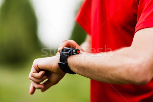 Koşucu bakıyor spor izlemek dağ iz Stok fotoğraf © blasbike