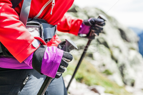 Woman hiking with backpack in mountains Stock photo © blasbike