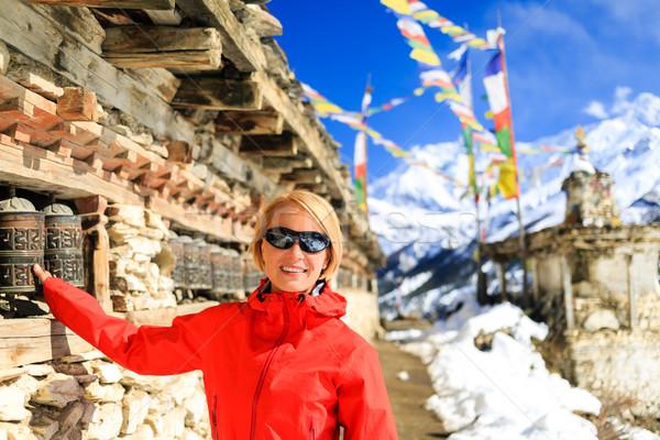 счастливым женщину турист молитвы колесо Непал Сток-фото © blasbike