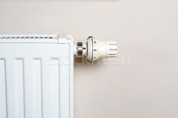Radiator with thermostat on wall Stock photo © blasbike
