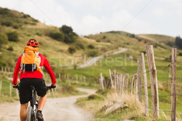 Biker cycling in beautiful mountains Stock photo © blasbike