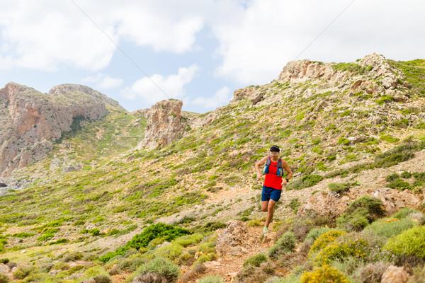 Trail running man in inspirational mountains Stock photo © blasbike