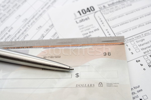 Check and silver pen with tax form Stock photo © blasbike